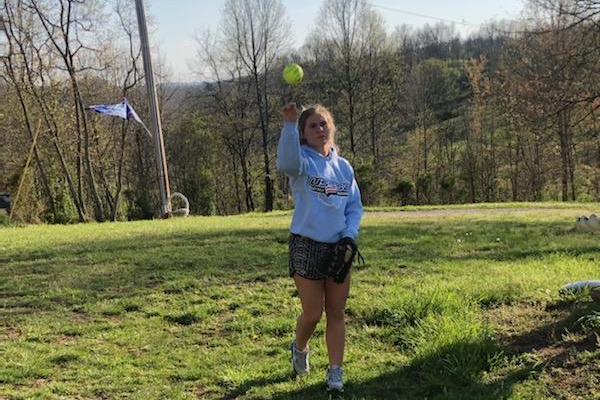 Halie Miller, a senior at Alexander High School, practices softball in her backyard. Photo courtesy Halie Miller